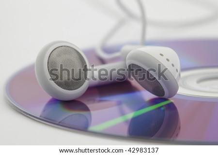 Headphones on cd, closeup on white background