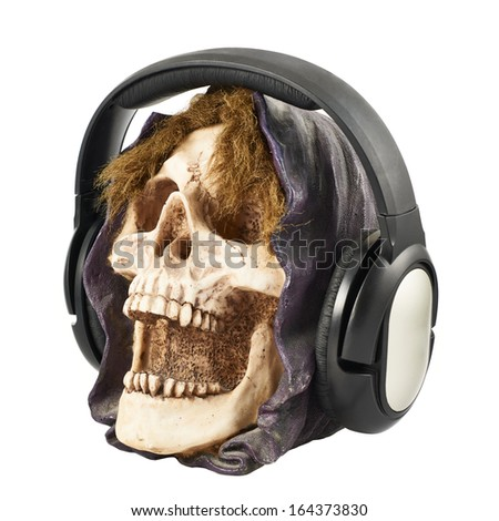 Headphones put on a ceramic skull head isolated over white background