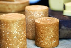 Heads of cheese of different grades and colors close-up. Selective focus. High quality photo