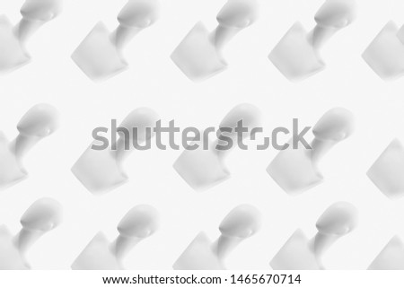 Heads of mannequins on a white background. Background of mannequins. Dummy. Many mannequins.