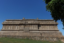 heads up wide view of exterior of a temple wall with multiple stone pillars monument under UNESCO World Heritage Site, one of the most traveled destination during holidays