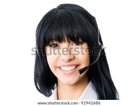 Headset. Customer service operator woman with headset smiling looking at camera. Isolated on white background.