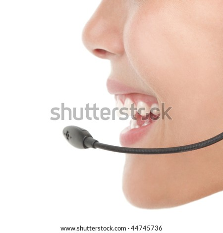 Headset woman in profile - closeup on white background.