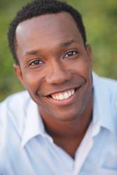 Headshot of a black man smiling
