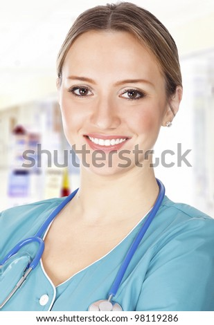 Headshot of a female doctor in a corridor of a hospital