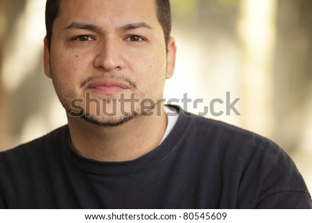 Headshot of a young Latino man
