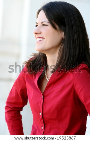 Headshot of an attractive business, corporate female in a suit. Suitable for a variety of commercial, finance and business themes.