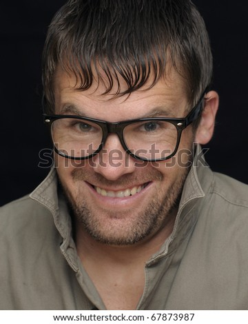 Headshot of crazy caucasian man with glasses