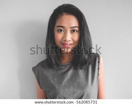 headshot of happy asian woman...