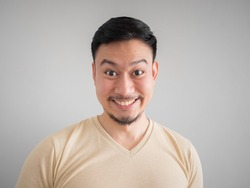 Headshot of happy face of Asian man with beard and mustache.