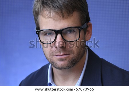 Headshot of male caucasian scientist with glasses