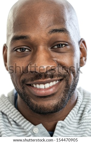 Headshot portrait of a handsome black man smiling in his late 20s isolated on white