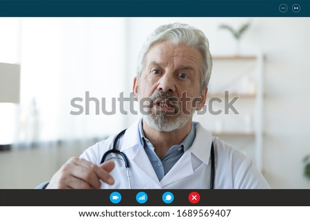 Headshot portrait screen application view of elderly male doctor consult client on computer online, mature man GP talk using video call with sick patient person on Webcam conference on laptop