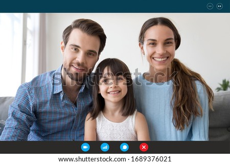 Headshot portrait screen application view of smiling young family with little daughter speak talk on video call with relatives, happy parents with small kid chat online use Web conference on laptop