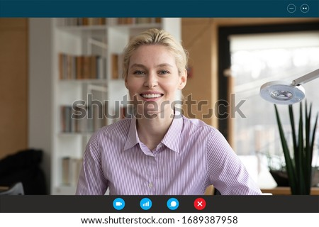 Headshot portrait screen application view of smiling young woman consultant speak talk on video call in office online, positive female specialist have web conference on laptop with client at home