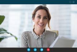 Headshot portrait screen view of young businesswoman consult client online using Webcam conference, smiling female employee speak talk on video call with partner or colleague from home office