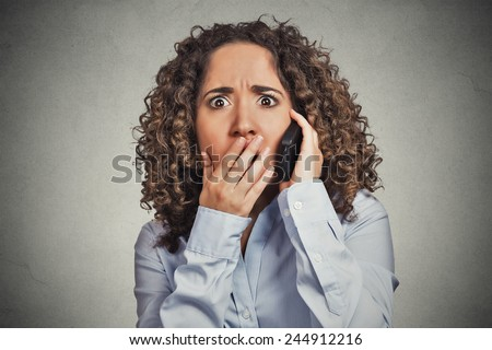 Headshot shocked stunned young woman getting bad news while talking on mobile phone isolated grey wall background. Negative human face expression emotion feelings life perception