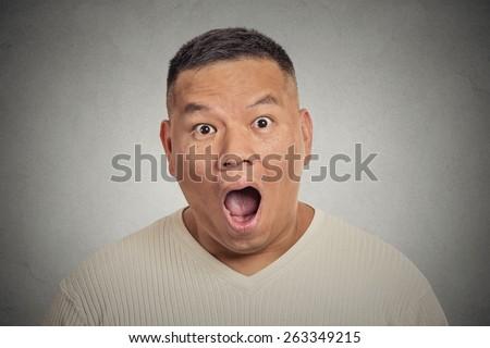 Headshot shocked surprised man isolated on grey background