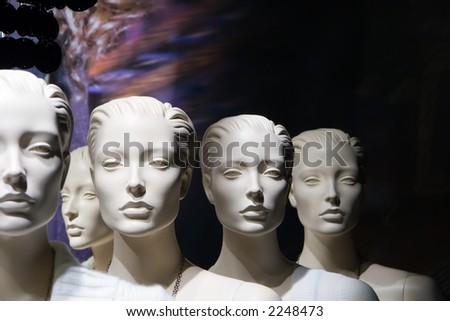 Headshots of several white mannequins