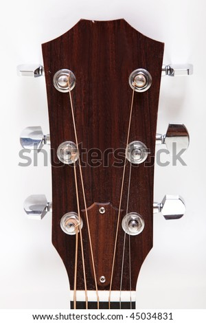 Headstock of a classical guitar over white background