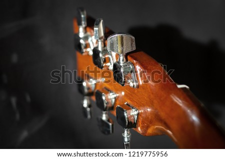 headstock with six tuning pegs - Shutterstock ID 1219775956
