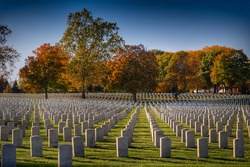 headstones are perfectly aligned  at the Dayton Nation Cemetery in Dayton, Ohio during the colorful Autumn season.