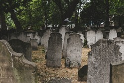 Headstones in Bunhill Fields, which is a former burial ground in central London. A headstone, tombstone, or gravestone is a stele or marker, usually stone, that is placed over a grave