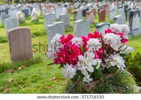 headstones on a graveyard in...