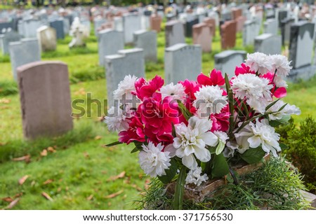 headstones on a graveyard in...