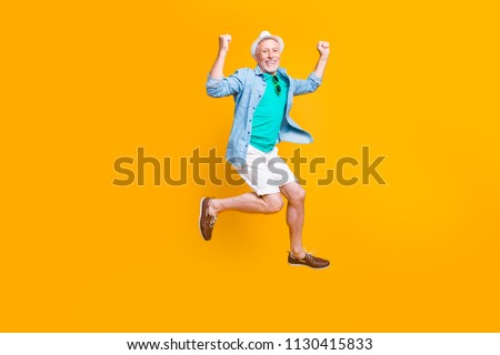 Headwear spectacles green glasses freedom happiness modern motion grey hair summer concept. Full length size photo portrait of cheerful careless funky funny runner isolated on vivid background