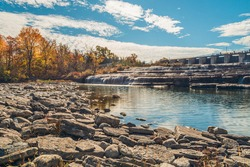 Healey Falls Havelock Ontario Canada featuring limestone step cascades with dam in autumn on a sunny day with blue sky