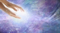 Healing energy flows where your attention goes - parallel female hands with high resonance white  energy flowing out on an ethereal purple pink blue background with copy space