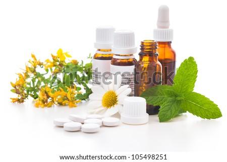 Healing herbs and medicinal bottles. Alternative medicine concept Foto stock ©