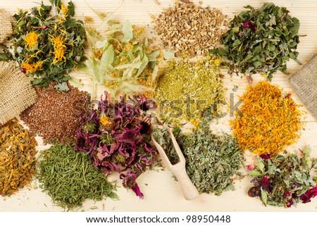 healing herbs on wooden table, herbal medicine, top view