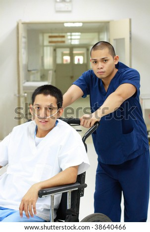 health aide with patient in wheelchair