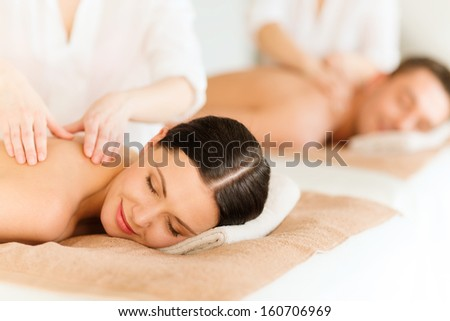 health and beauty, resort and relaxation concept - couple in spa salon getting massage #160706969