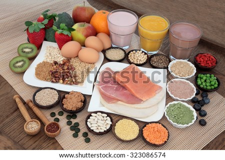 Shutterstock Health and body building food with fish and meat, supplement powders, vitamin tablets, pulses, nuts, vegetables, fruit and high protein and juice smoothie shakes.