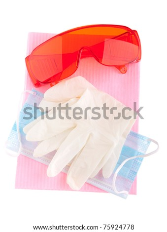 health and safety equipment (glasses, gloves, mask and bib) to prevent cross infection (isolated on white)