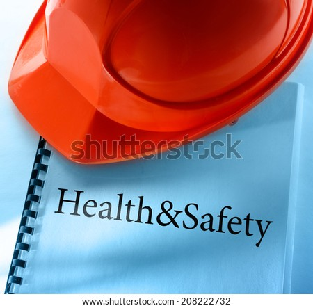 Health and safety with red helmet
