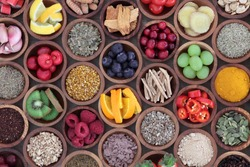 Health and super food  to boost immune system in wooden bowls, high in antioxidants, anthocyanins, minerals and vitamins. Also good for cold and flu remedy.