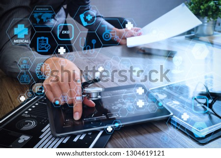 Health care and medical technology services concept with flat line AR interface.Medicine doctor working with modern tablet computer and documents. #1304619121