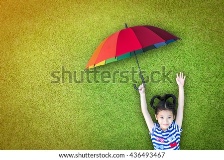 Health care assurance and life insurance concept with happy asian girl kid holding umbrella uv protection on sunny day