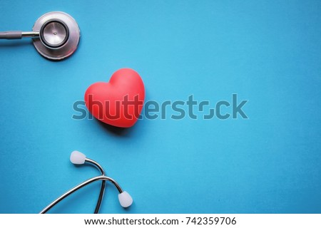 Health care check up with red heart and Stethoscope on blue background. Health care background and copy space used for add message or graphic montage.