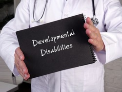 Health care concept about Developmental Disabilities with sign on the sheet.