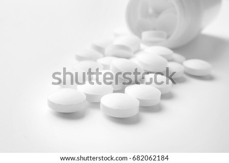 Health care concept. Pills and jar on white background #682062184