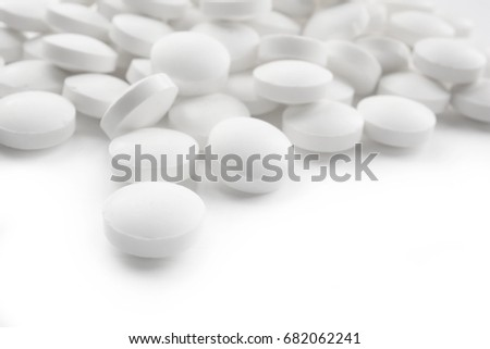 Health care concept. Round pills on white background #682062241