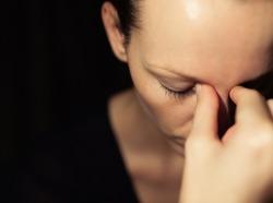 Health care concept - Woman suffering from headache.