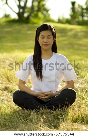 Health care concept: young woman doing yoga meditation
