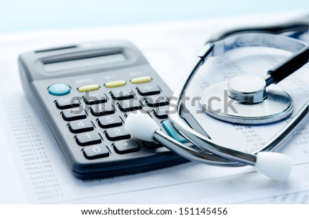Health care costs Stethoscope and calculator symbol for health care costs or medical insurance