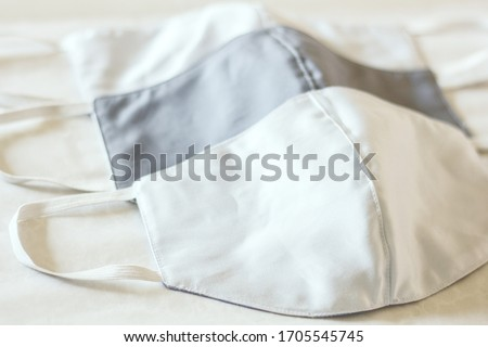 health care facial salu&muslin sew mask use for protecting from corona virus anti bacteria dust PM2.5 air pollution triple filter protection layers reusable cloth mask isolate on top white background. Foto stock ©